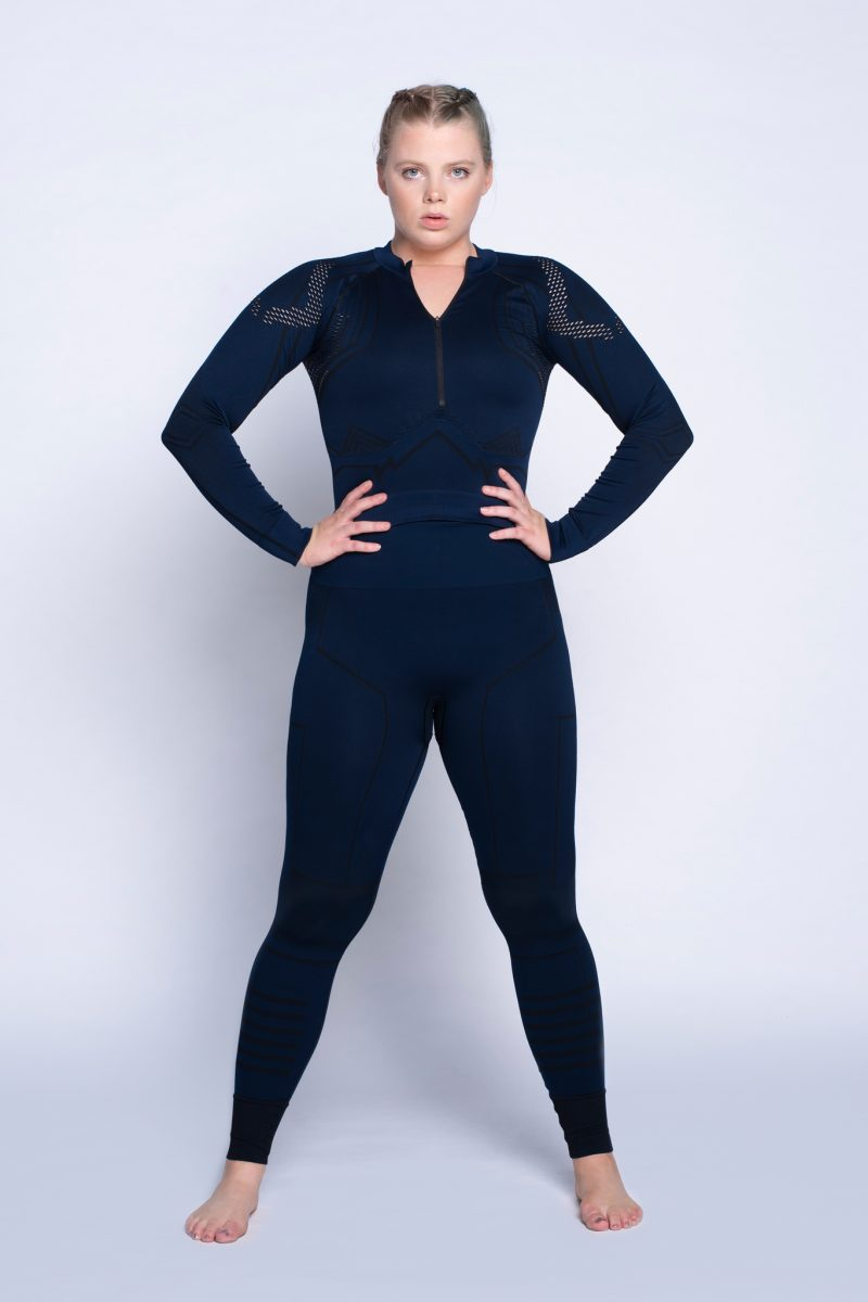 girl standing strong in activewear collection studio nanette lindeman