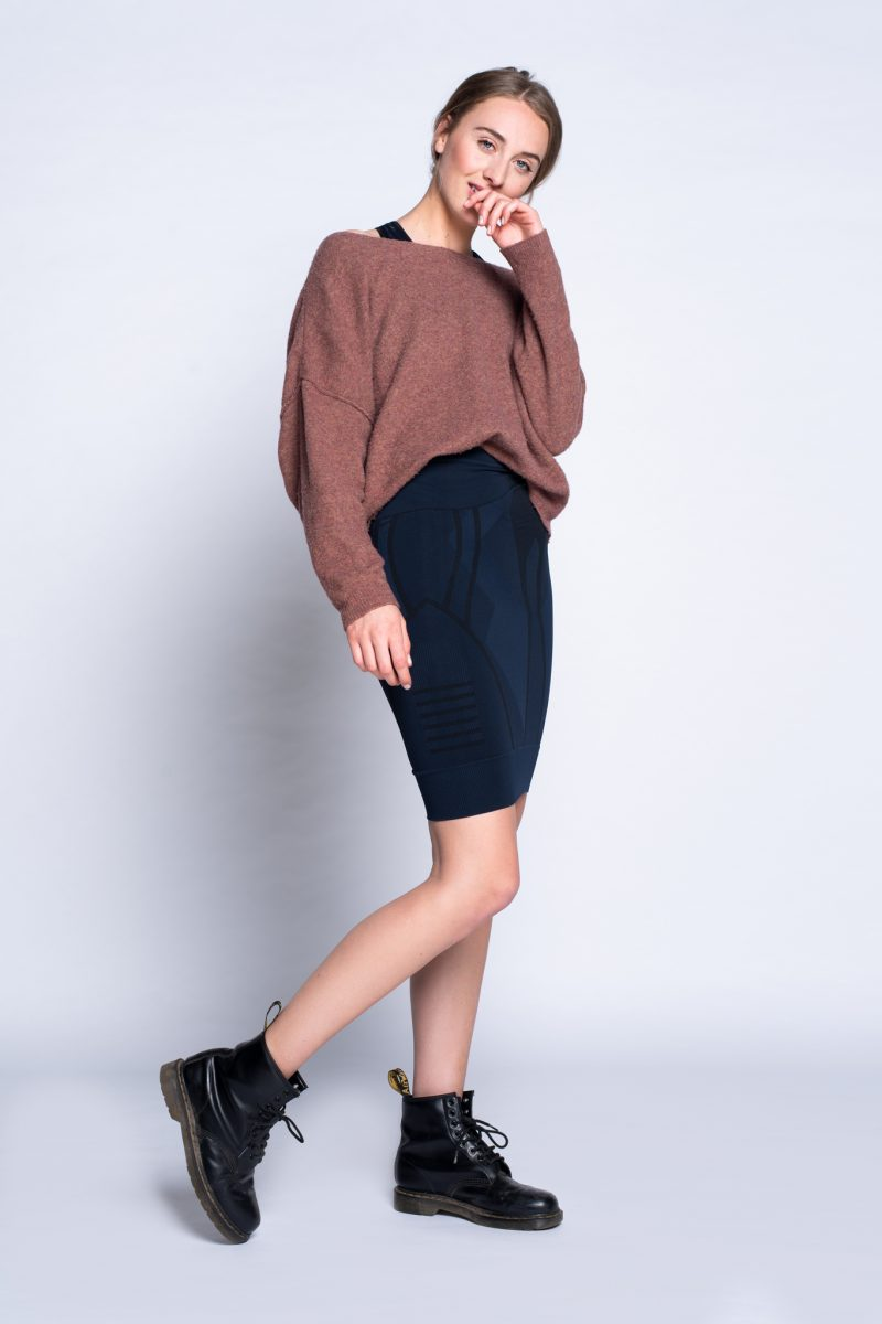 girl wearing activewear as pencil skirt with comfortable sweater